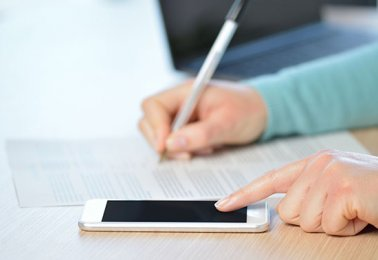 Mobile device with pen and paper in background thumbnail